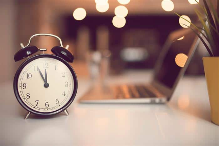 Picture of a clock and laptop