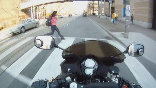 girl running in front of traffic
